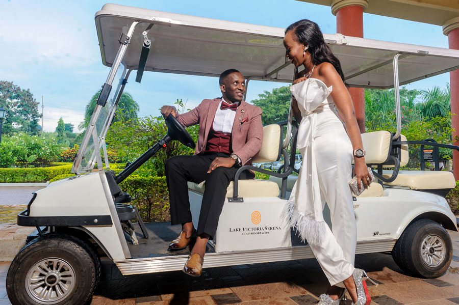 Edwin and Christabel pose for a photo during their wedding