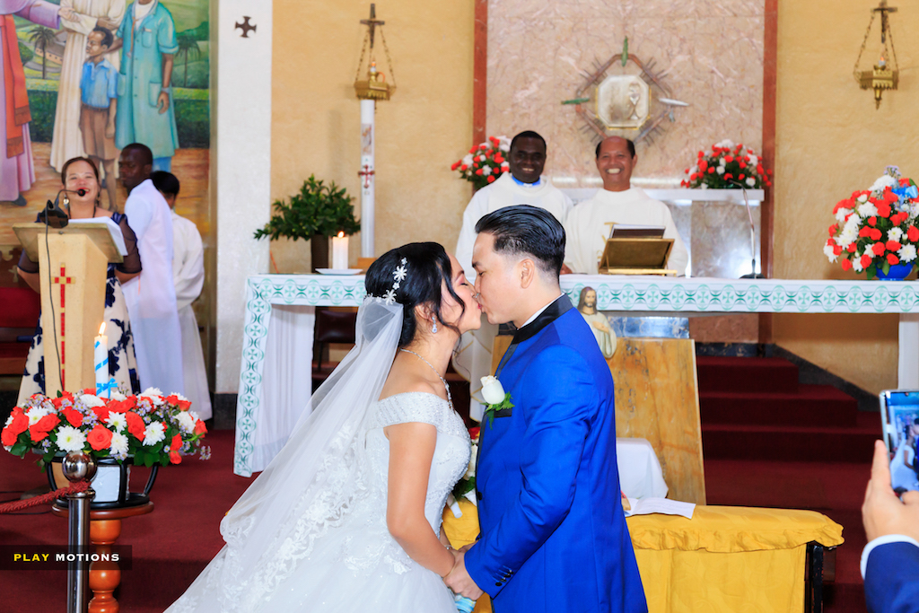 Michael weds Maricris Philippines wedding in Uganda in church exchanging vows